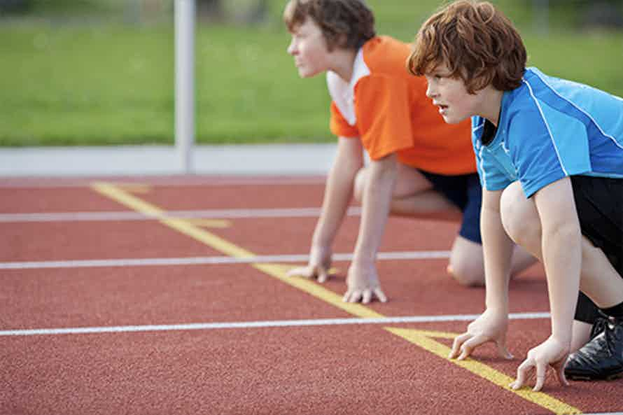 Children on a track and ready to race as part of the Fitnessgram program.