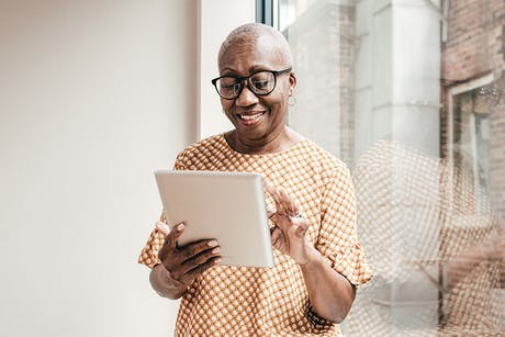 Woman reviewing information about cancer
