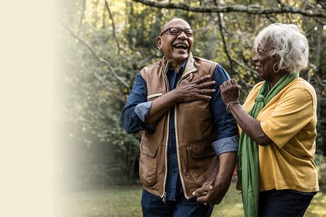 Couple laughing because their chronic disease self-management program is working